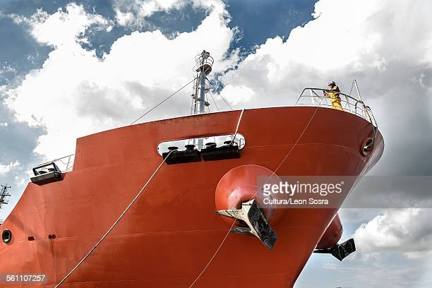 low angle view of worker on board oil tanker - tanker stock photos and pictures