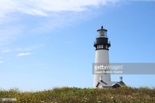 Low Angle View Of Yaquina Head Lighthouse Against Blue Sky