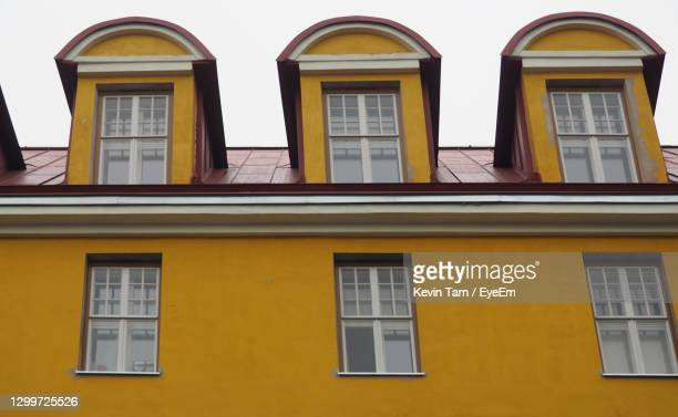 low angle view of yellow building - eyeem kevin tam stock pictures, royalty-free photos & images