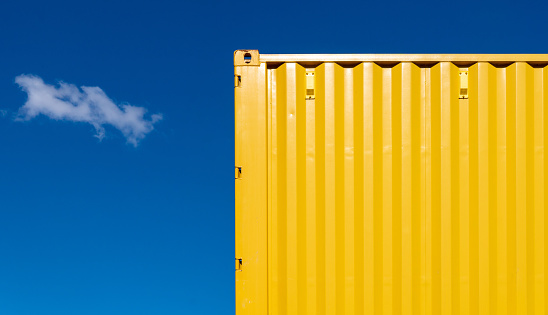 Low Angle View Of Yellow Cargo Container Against Sky - gettyimageskorea
