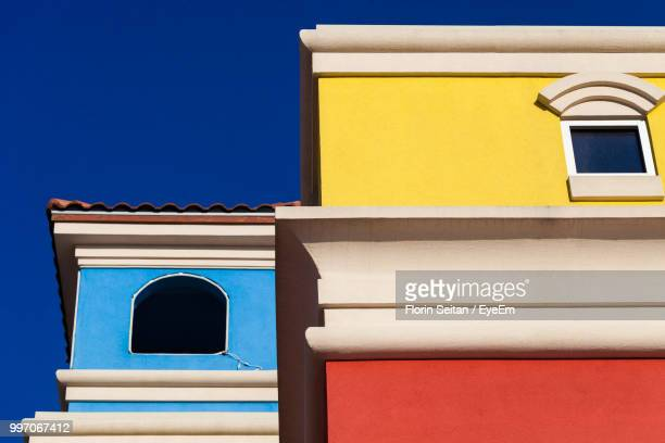 low angle view of yellow house against sky - tijuana stock pictures, royalty-free photos & images