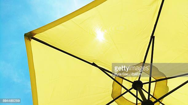 Low Angle View Of Yellow Parasol Against Sky At Beach