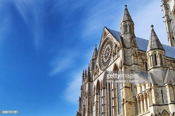 low angle view of york minster against blue sky - york minster stock photos and pictures