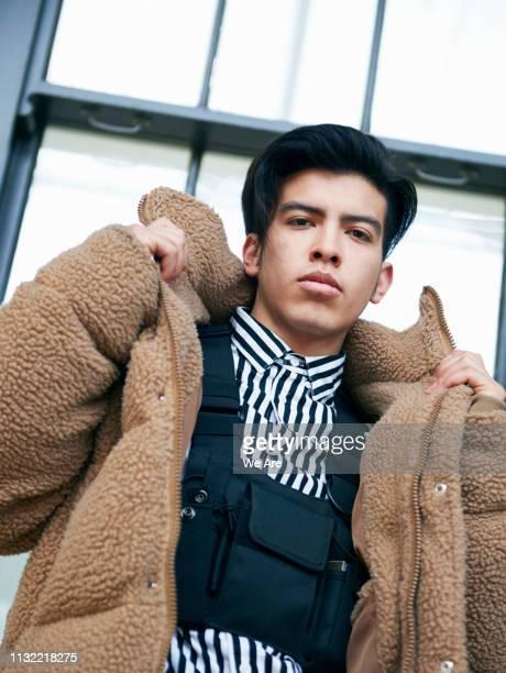 low angle view of young man. - fleecejas stockfoto's en -beelden