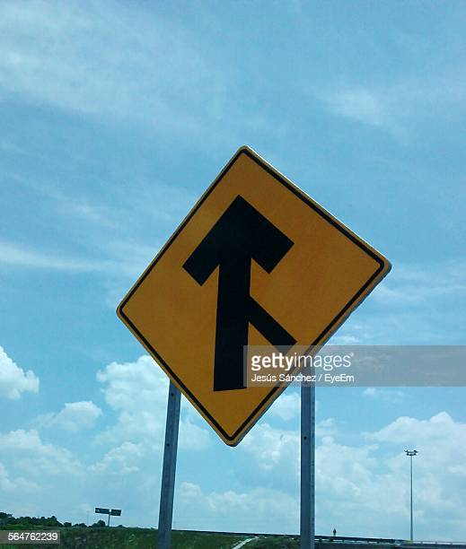 Low Angle View Road Merging Sign