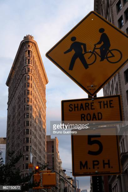 Low angle view road sign against flatiron building