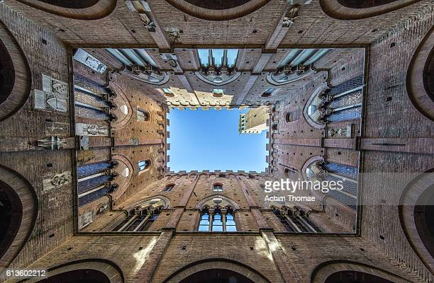 Low angle view to the sky inside of Torre del Mangia; Siena, Tuscany, Italy, Europe