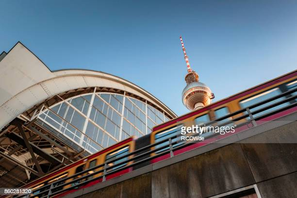 low angle view with tv tower and s-bahn - central berlin stock photos and pictures