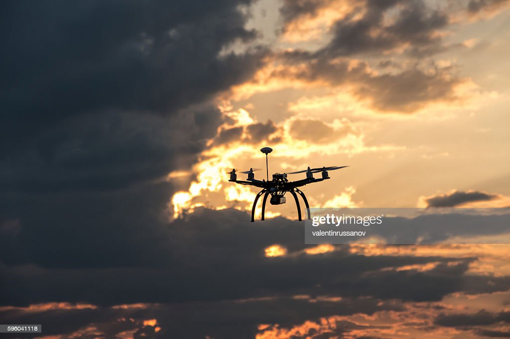 Low angle viw of flying drone : Stock Photo