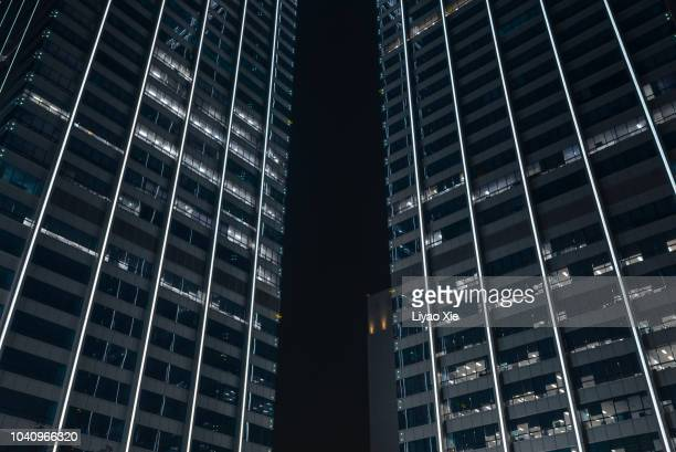 low angled view of skyscrapers - liyao xie stock pictures, royalty-free photos & images