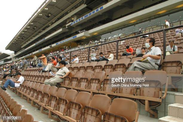 Low attendance of punters on a racing day at Sha Tin Racecourse 18 May 2003