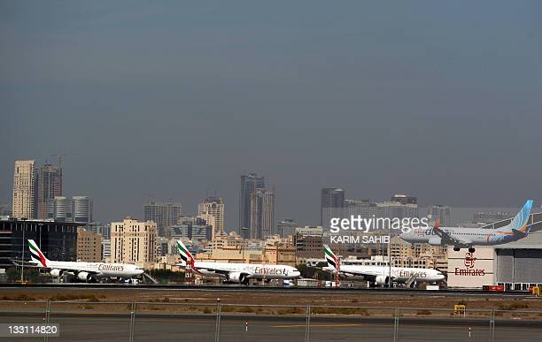 A low budget commerical airliner Fly Dubai attempts to land at the tarmac of Dubai International airport on November 17 2011 Gulf carriers marked...