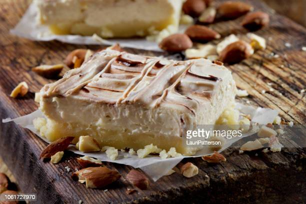 low carb no bake cheesecake with an almond flour crust - fudge stock pictures, royalty-free photos & images