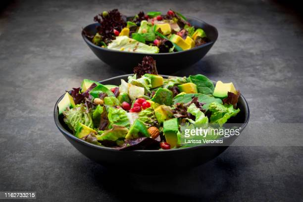 low carb salad with lettuce, avocado, roasted seeds, almonds and soy beans - larissa veronesi stock-fotos und bilder