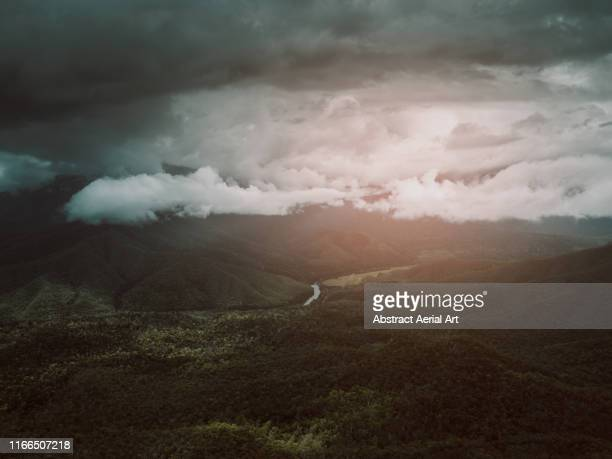 low clouds above mountainous landscape photographed from the air, gilles range, queensland, australia - wilderness stock pictures, royalty-free photos & images