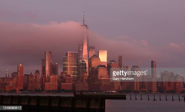 Low clouds float through lower Manhattan as the sun sets in New York City on June 11, 2020 as seen from Jersey City, NJ.