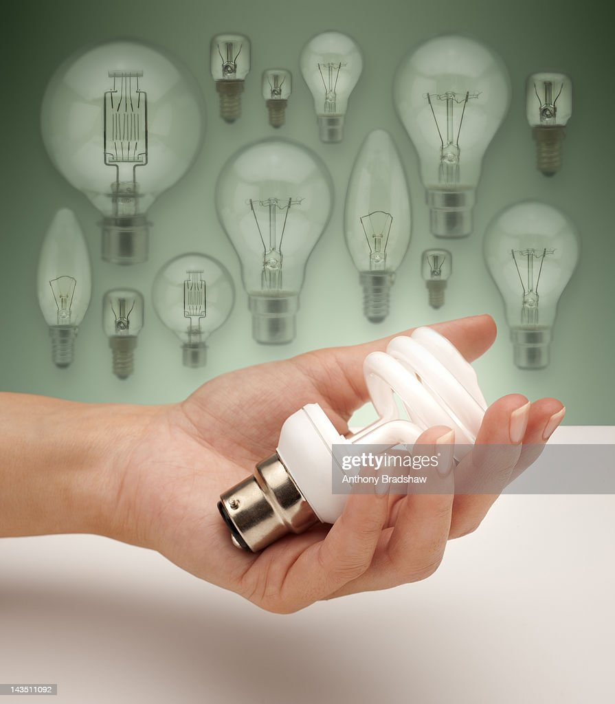 Low energy light bulb against old fashioned bulbs  Stock Photo & Low Energy Light Bulb Against Old Fashioned Bulbs Stock Photo ... azcodes.com