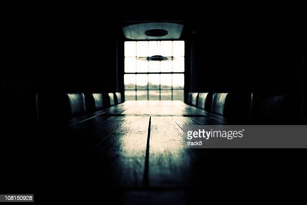 Low key empty boardroom scene; black and white