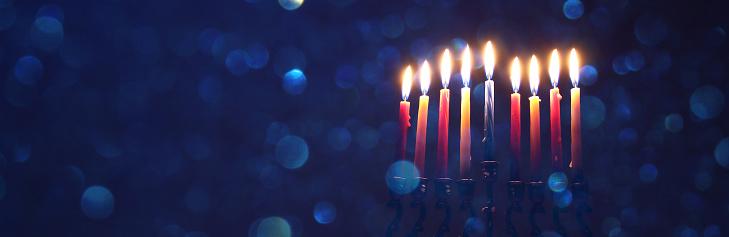 low key image of jewish holiday Hanukkah background with menorah (traditional candelabra) 869797766