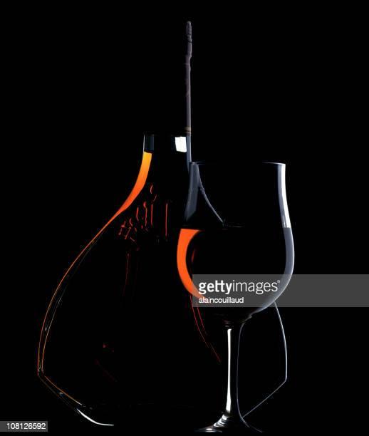 Low Key Lit Portrait of Cognac Bottle and Glass