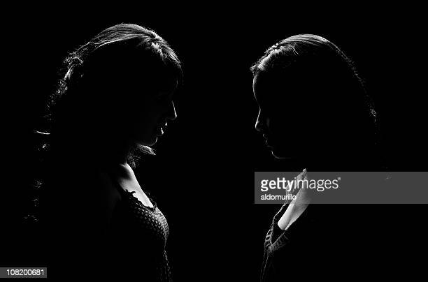 Low Key Lit Portrait of Two Woman Facing Each Other