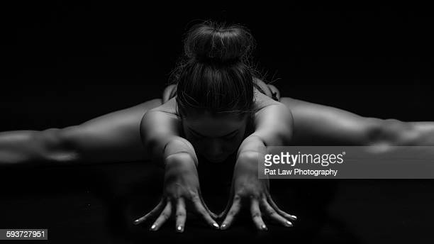 low key portrait of young woman - artistic gymnastics stock pictures, royalty-free photos & images