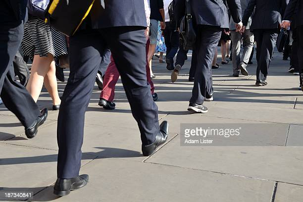 Low level commuter image of suited City businessmen, bankers, office workers and financiers walking to work in the Daily Rush Hour commute on London...