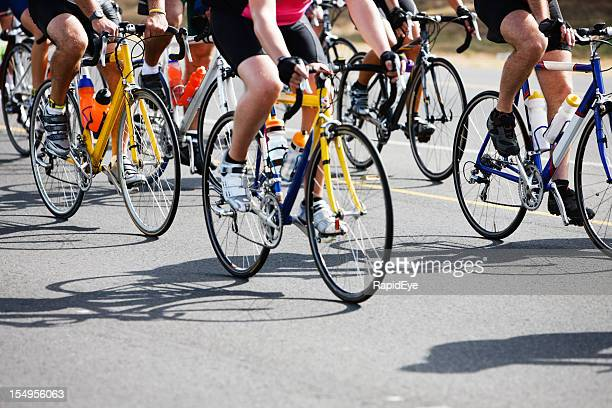 low level view of racing cyclists and their shadows - cycling event stock pictures, royalty-free photos & images
