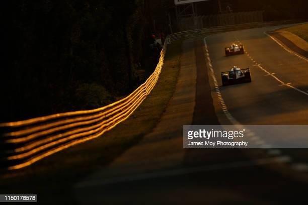 Low light action as the sun sets during the Le Mans 24 Hour Race at the Circuit de la Sarthe on June 15, 2019 in Le Mans, France.