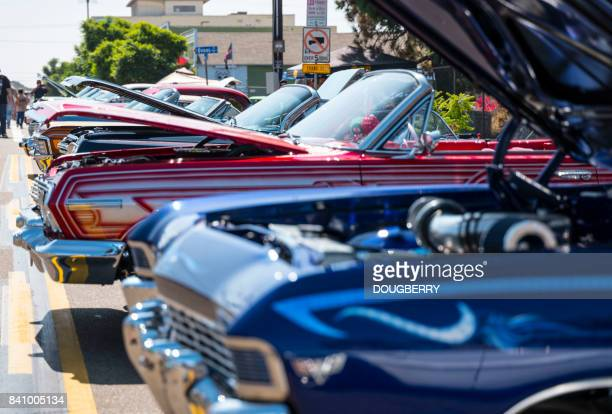 low rider vehicles at car show san diego california - low rider stock pictures, royalty-free photos & images