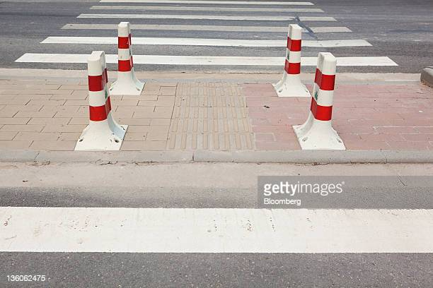 Low rise curbs for bicycle access are in place at a cross walk at the SinoSingapore Tianjin Ecocity in the Binhai New Area of Tianjin China on Monday...