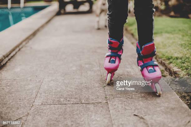 low section girl inline skating - inline skate stock photos and pictures