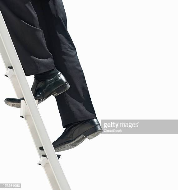 low section of a business man climbing the ladder - step ladder stock pictures, royalty-free photos & images