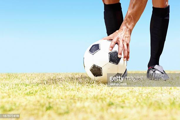 low section of a footballer placing the ball on field - positioning stock pictures, royalty-free photos & images