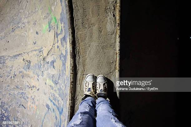 low section of a man standing outdoors - adriana duduleanu stock photos and pictures