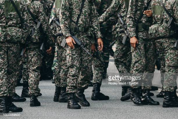 low section of army soldiers on road - military uniform stock pictures, royalty-free photos & images