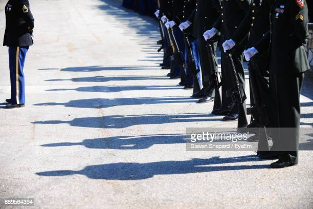 low section of army soldiers standing in a row - military parade stock pictures, royalty-free photos & images