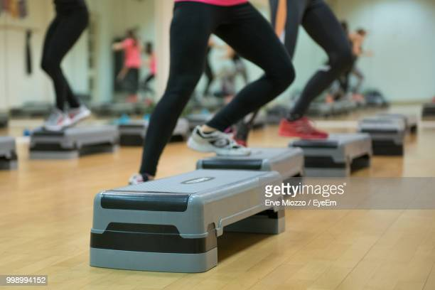 Low Section Of Athletes Exercising In Health Club