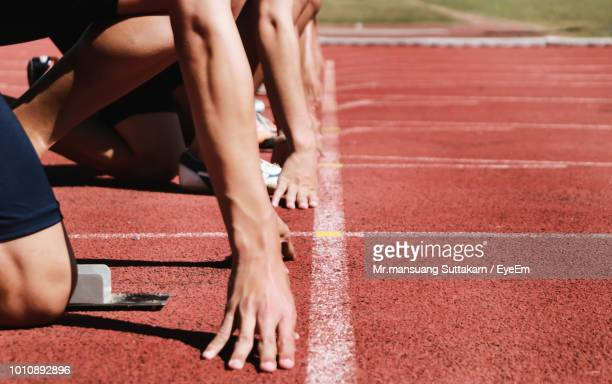 low section of athletes on running track - sports race stock pictures, royalty-free photos & images