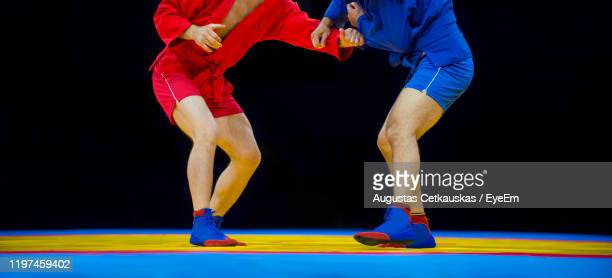 low section of athletes wrestling - cetkauskas stock pictures, royalty-free photos & images