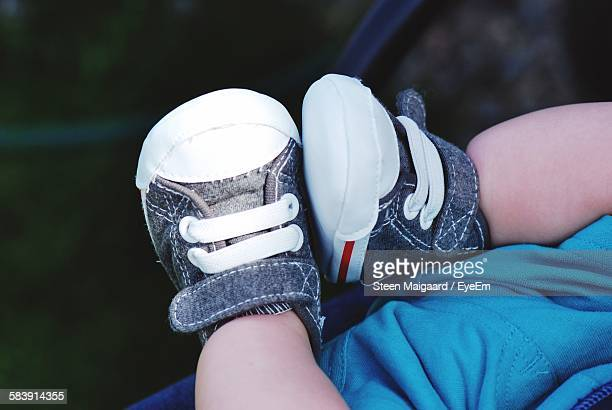 Low Section Of Baby Wearing Shoes