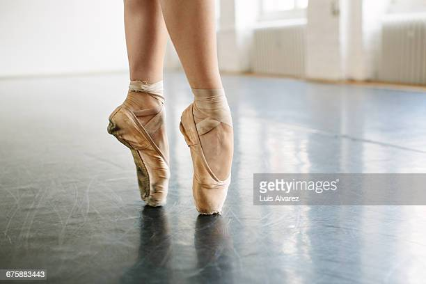 low section of ballerina standing on tip toes at s - ballet dancer stock pictures, royalty-free photos & images
