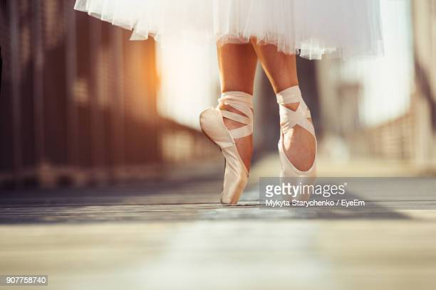 low section of ballet dancer dancing - ballet dancer stock pictures, royalty-free photos & images