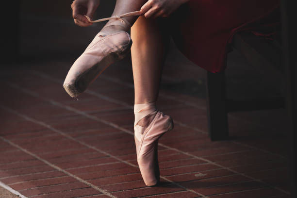 Low section of ballet dancer putting on her shoes,Bountiful,Utah,United States,USA