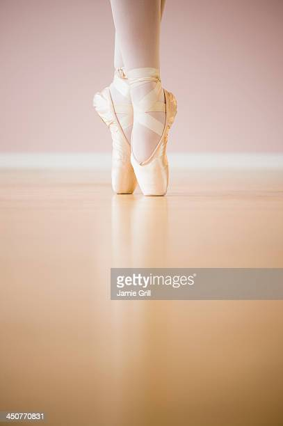Low section of ballet dancer (16-17) tiptoing