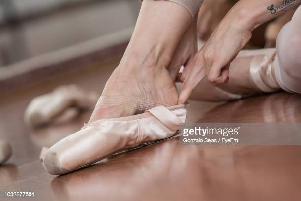 low section of ballet dancer wearing shoe - ballerina feet stock photos and pictures