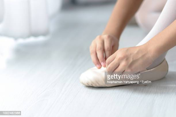 low section of ballet dancer wearing shoes - ballerina feet stock photos and pictures
