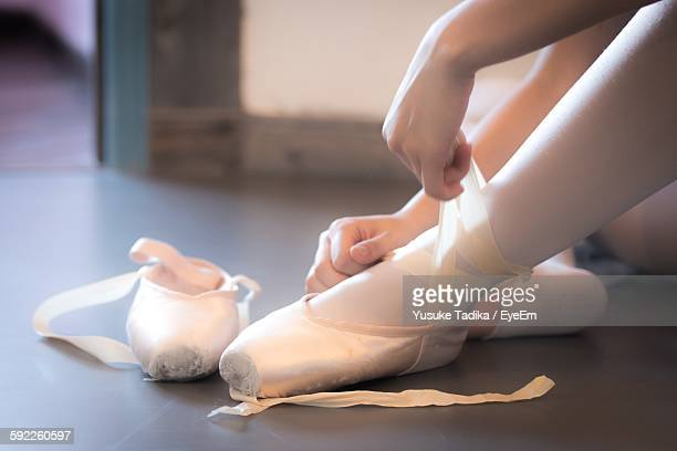 Low Section Of Ballet Dancer Wearing Shoes