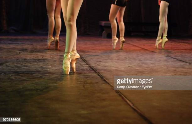 low section of ballet dancers on stage - ballerina feet stock photos and pictures