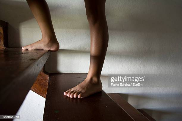 Low Section Of Boy Moving Up On Steps